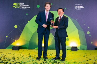Chairman Mr Patrick Chong & Group CEO Dr Wolfgang Baier of LUXASIA receiving the Singapore's Best Managed Companies award, conferred by Deloitte