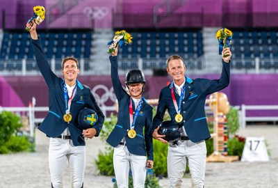 Team Sweden on the podium. (L to R): Henrik von Eckermann, Malin Baryard-Johnsson and Peder Fredricson. Almost a century since Sweden last won Olympic Jumping Team gold and tonight they did it with both style and grace at the Tokyo 2020 Olympic Games in Baji Koen Equestrian Park. (FEI/Arnd Bronkhorst)